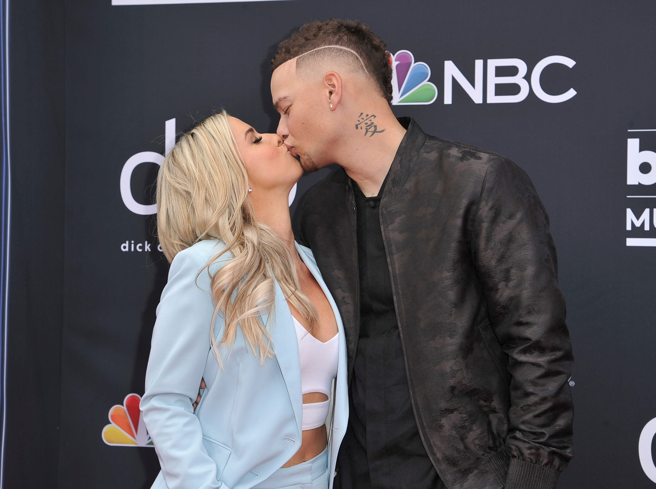 Katelyn Jae, left, and Kane Brown kiss as they arrive at the Billboard Music Awards on Wednesday, May 1, 2019, at the MGM Grand Garden Arena in Las Vegas.