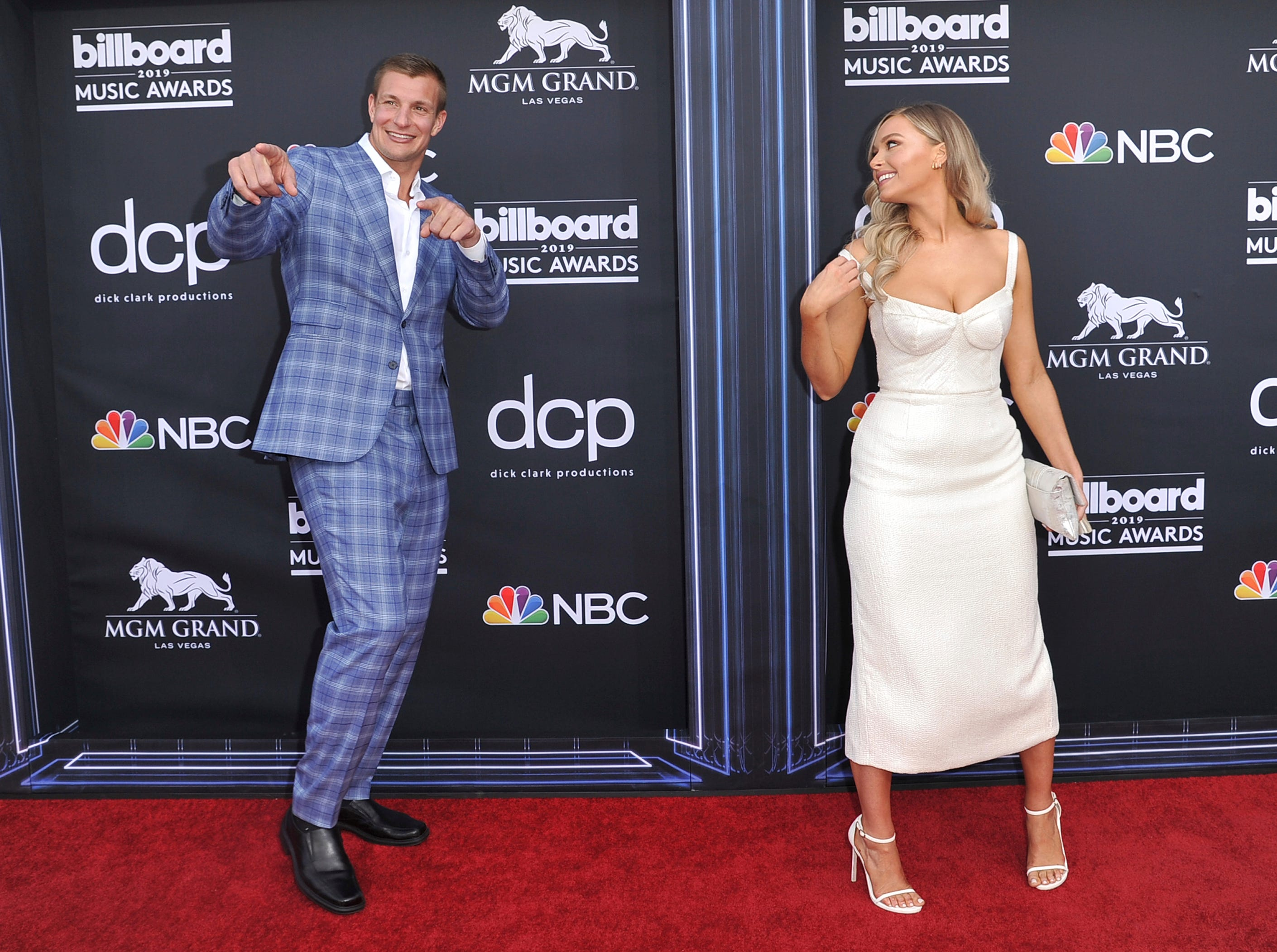 Rob Gronkowski, left, and Camille Kostek arrive at the Billboard Music Awards on Wednesday, May 1, 2019, at the MGM Grand Garden Arena in Las Vegas.