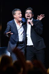 Jason Crabb, right, performs with Michael W. Smith during the 35 Years of Friends: Celebrating the Music of Michael W. Smith concert at Bridgestone Arena in Nashville, Tenn., Tuesday, April 30, 2019.