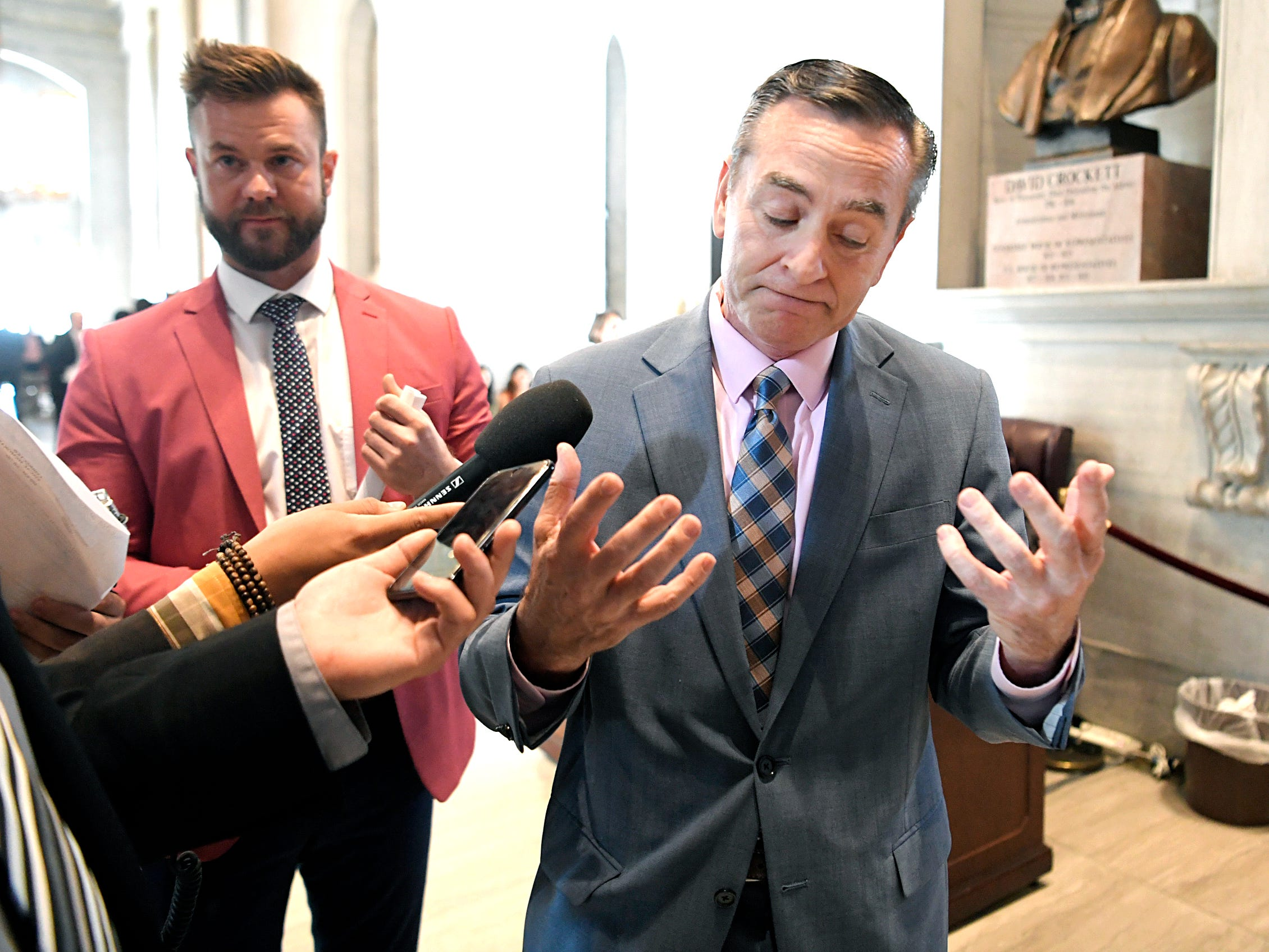 Reporters follow and ask questions of Speaker Glen Casada, right, regarding HB 939 during the General Assembly session in Nashville on Wednesday, May 1, 2019. Casada's chief of staff, Cade Cothren, stands at left.