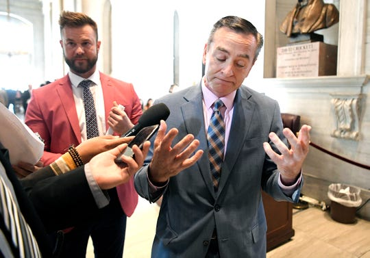 Reporters follow and ask questions of Speaker Glen Casada regarding HB 939 during session in Nashville on Wednesday, May 1, 2019.