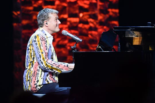 Michael W. Smith performs while wearing his first tour jacket during the 35 Years of Friends: Celebrating the Music of Michael W. Smith concert at Bridgestone Arena in Nashville, Tenn., Tuesday, April 30, 2019.
