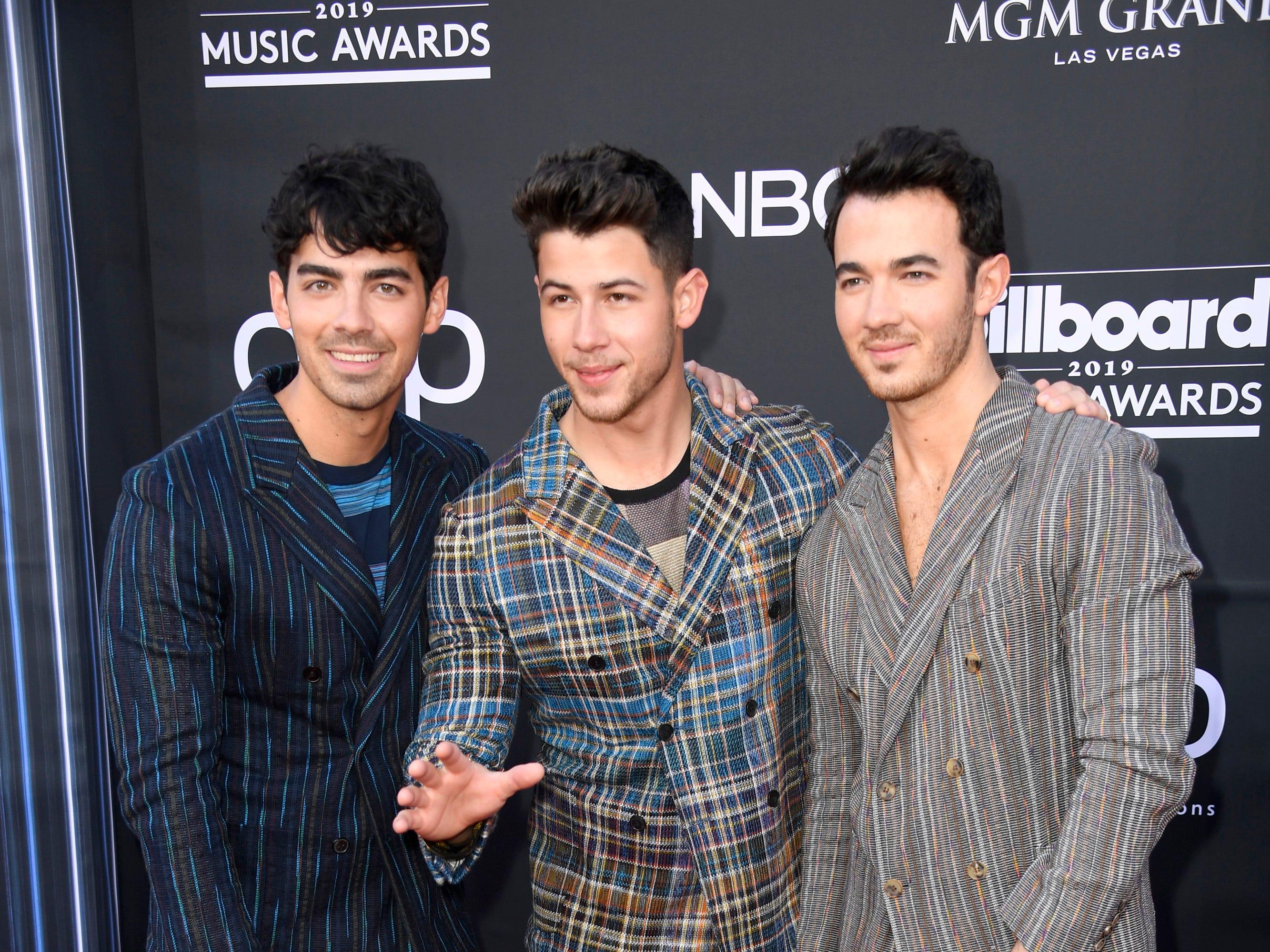 (L-R) Joe Jonas, Nick Jonas, and Kevin Jonas of Jonas Brothers attend the 2019 Billboard Music Awards at MGM Grand Garden Arena on May 01, 2019 in Las Vegas, Nevada.