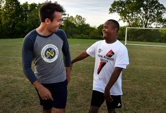 Nashville SC defender Taylor Washington shares a laugh with special olympian Caleb Tardy 15, during a soccer clinic at Flagpole Park Tuesday, April 30, 2019 in Brentwood, Tenn.