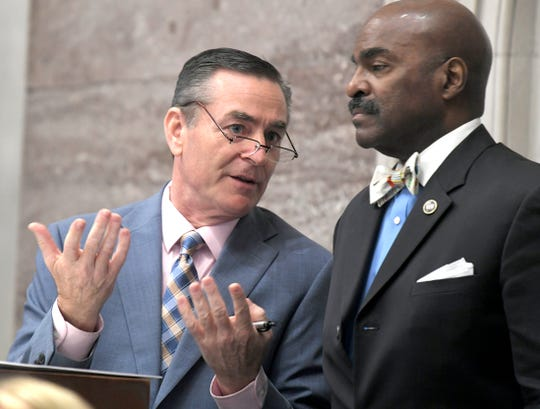 Speaker Glen Casada and Representative G. A. Hardaway speak together during session in Nashville on May 1.