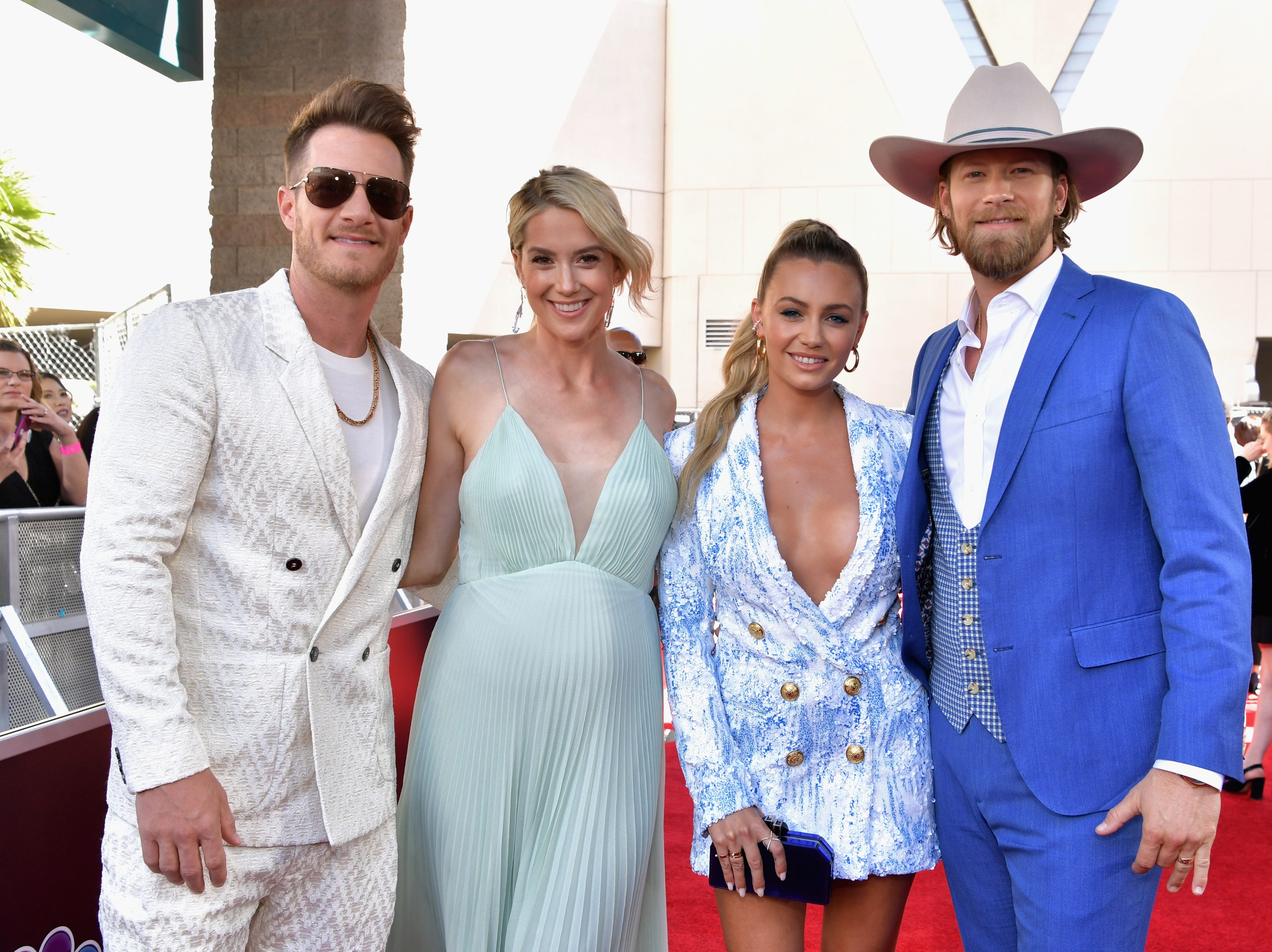 Brian Kelley of Florida Georgia Line, Brittney Marie Cole, Hayley Stommel, and Tyler Hubbard of Florida Georgia Line attend the 2019 Billboard Music Awards at MGM Grand Garden Arena on May 1, 2019 in Las Vegas, Nevada.