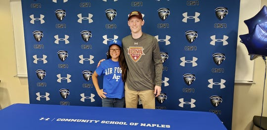 Community School of Naples seniors Katherine Carr and Parker Weiss signed letters of intent to play their sports in college on Wednesday. Carr will be a diver at Air Force, while Weiss will play basketball at Iona.