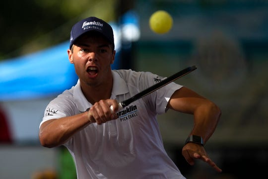 Ben Johns returns the ball to his opponent Tyson McGuffin during the Men's Pro Singles championship game during the U.S. Open Pickleball Championships on the Zing Zang Championship Court at East Naples Community Park on Sunday. The championships conclude .S.aturday.