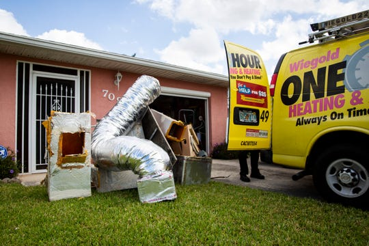 Employees from One Hour Air Conditioning and Heating replace the air conditioning unit at Oliver and Mary Marcelli's house free of charge in Naples Park on Wednesday, May 1, 2019.