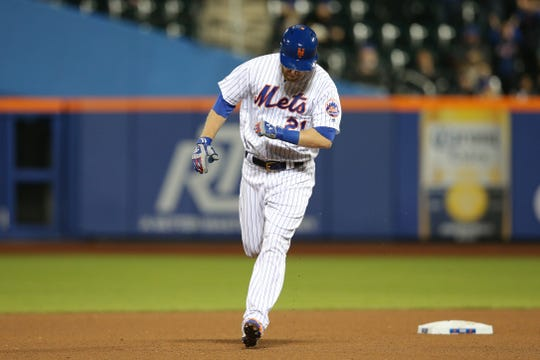 New York Mets third baseman Todd Frazier (21) rounds the bases after hitting a go-ahead solo home run against the Cincinnati Reds during the seventh inning at Citi Field.