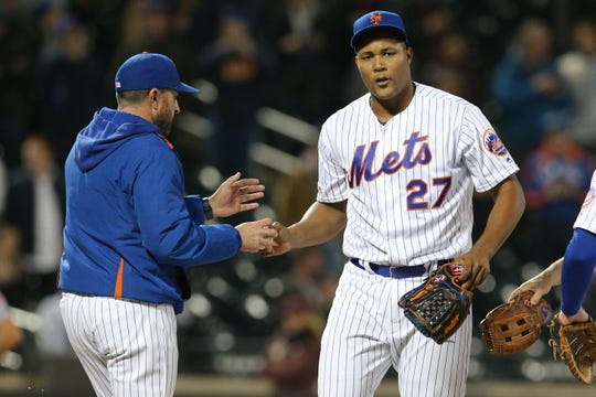 Apr 30, 2019; New York City, NY, USA; New York Mets manager Mickey Callaway (36) relieves New York Mets relief pitcher Jeurys Familia (27) during the ninth inning against the Cincinnati Reds at Citi Field. Mandatory Credit: Brad Penner-USA TODAY Sports