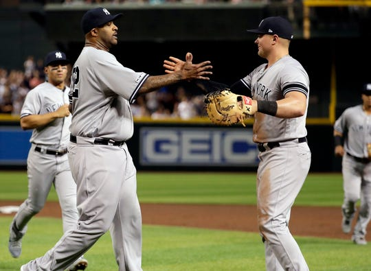 New York Yankees starting pitcher C.C. Sabathia, left, celebrates with first baseman Luke Voit after throwing his 3,000th career strikeout, during the second inning of the team's game against the Arizona Diamondbacks, Tuesday, April 30, 2019, in Phoenix.