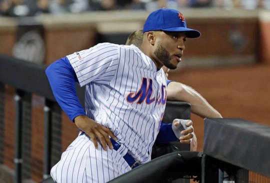 New York Mets' Robinson Cano watches his team play during the seventh inning of a game against the Cincinnati Reds on Tuesday, April 30, 2019, in New York.