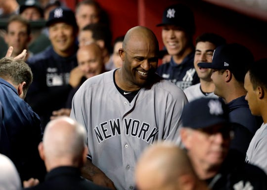 New York Yankees starting pitcher C.C. Sabathia walks through the dugout after throwing his 3,000th career strikeout, during the second inning of the team's  game against the Arizona Diamondbacks, Tuesday, April 30, 2019, in Phoenix.