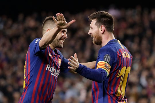 Barcelona's Lionel Messi celebrates with Barcelona's Jordi Alba after scoring his side's third goal during the Champions League semifinal, first leg, soccer match between FC Barcelona and Liverpool at the Camp Nou stadium in Barcelona, Spain, Wednesday, May 1, 2019. (AP Photo/Emilio Morenatti)