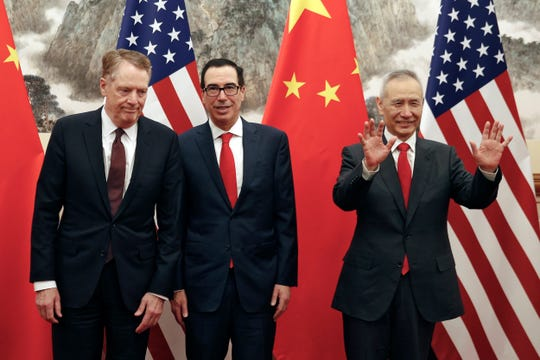 Chinese Vice Premier Liu He, right, gestures as U.S. Treasury Secretary Steven Mnuchin, center, chats with his Trade Representative Robert Lighthizer, left, before they proceed to their meeting at the Diaoyutai State Guesthouse in Beijing, Wednesday, May 1, 2019.