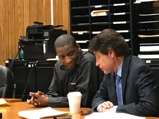 Defendant Harold Johnson ( L ), with his attorney, Gregory Aprile, on Wednesday.