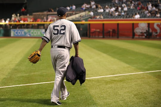 Starting pitcher CC Sabathia (52) of the New York Yankees walks out to the bullpen before the MLB game against the Arizona Diamondbacks at Chase Field on April 30, 2019 in Phoenix, Arizona.
