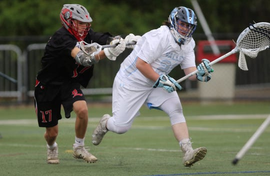 Hunter Rovere, of Wayne Valley, tries to get away from the tough defense from Jake Querrazzi, of Lakeland. Wednesday, May 1, 2019