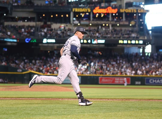 May 1, 2019; Phoenix, AZ, USA; New York Yankees first baseman Luke Voit rounds the bases after hitting a solo home run in the sixth inning against the Arizona Diamondbacks at Chase Field.
