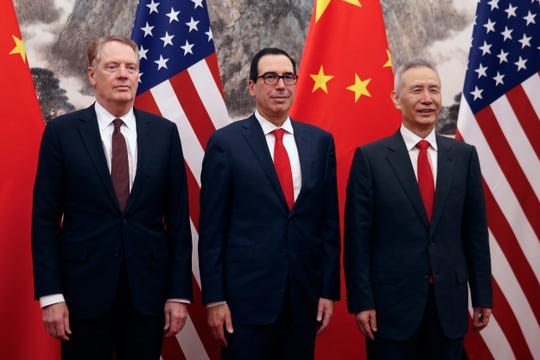 Chinese Vice Premier Liu He, right, poses with U.S. Treasury Secretary Steven Mnuchin, center, and U.S. Trade Representative Robert Lighthizer, left, before they proceed to their meeting at the Diaoyutai State Guesthouse in Beijing, Wednesday, May 1, 2019.