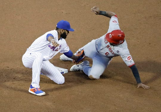 New York Mets' Amed Rosario, left, tags out Cincinnati Reds' Phillip Ervin as Ervin attempted to steal second base during the second inning of a baseball game Tuesday, April 30, 2019, in New York. (AP Photo/Frank Franklin II)