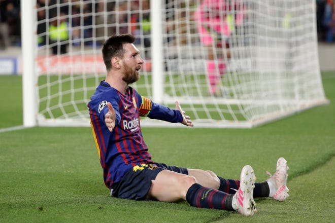 Barcelona's Lionel Messi celebrates after scoring his side's third goal during the Champions League semifinal, first leg, soccer match between FC Barcelona and Liverpool at the Camp Nou stadium in Barcelona, Spain, Wednesday, May 1, 2019. (AP Photo/Emilio Morenatti)