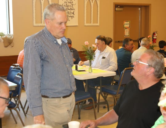 Pastor Dan Phelps (left) from First Evangelical Presbyterian Church in Artesia visits with Mike Spencer, worship and discipleship pastor at West Main Baptist Church in Artesia, during the 108th May Day Breakfast at First Evangelical Presbyterian Church.