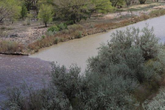 The San Juan River, right, meets the Animas River, Wednesday, May 1, 2019, in Farmington.