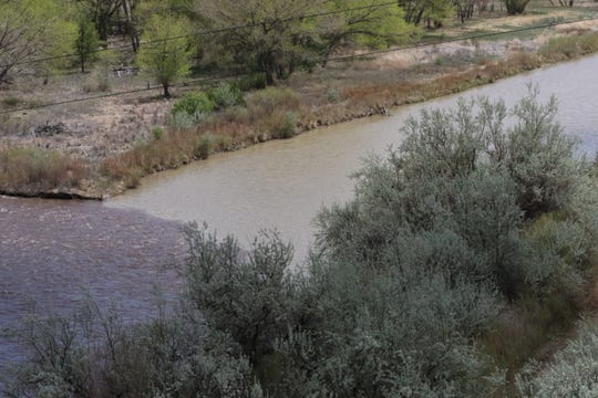 The San Juan River, right, meets the Animas River, Wednesday, May 1, 2019, in Farmington.