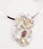 A tourmaline stone on sterling silver necklace, created especially for the auction, is a stunner.