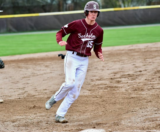 Seaholm's Alex Maxwell rounds third and heads home in a game against North Farmington on April 30, 2019.