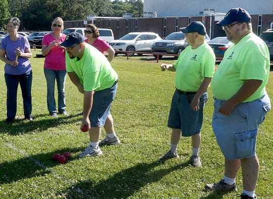 Special Olympians practice their Bocce skills for the upcoming Louisiana State Special Olympic Games to be held this month in Hammond, La.