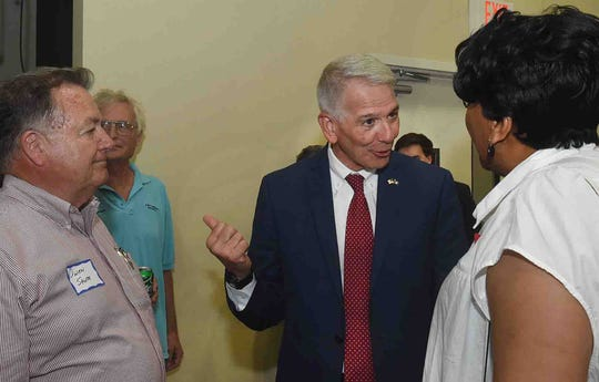 Ralph Abraham, candidate for governor, talks with Owen Shute and Polly Pickney during a gathering Tuesday at the Equine Center in Opelousas.