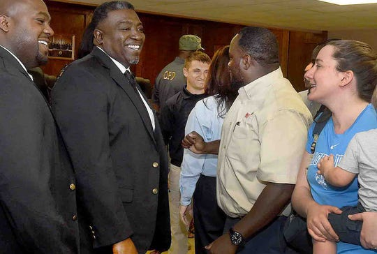 """Raquella Manuel, right, St. Landry Chamber of Commerce president and CEO, is introduced to members of the Opelousas Police Department during a """"meet and greet"""" event held Tuesday at the Opelousas City Hall."""