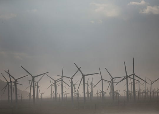 Dust blows through the wind mills outside of Palm Springs on Tue. April 30, 2019.
