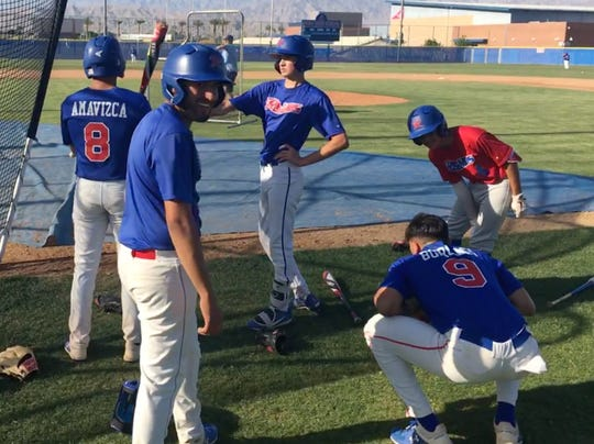 Indio players interact as they await their turn in the batting cage during Tuesday's practice.