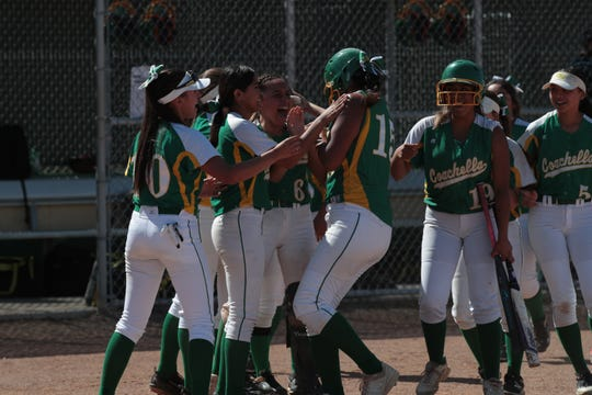 Cheyenne Sandoval celebrates with teammates after her first home run of the afternoon, Coachella, Calif., April 30, 2019.