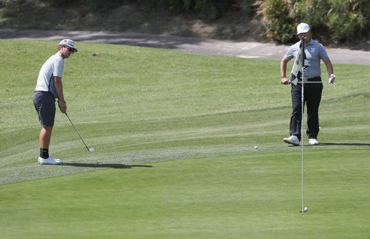 Chris Wardrup of Palm Desert sinks a chip on the 4th hole for a birdie during the Desert Empire League boys golf individual prelims at the Gary Player Signature Course, Westin Mission Hills Resort in Rancho Mirage, May 1, 2019.