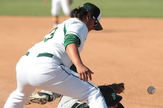 Coachella Valley's Samuel Esparza loses the ball while tagging up on first base, Coachella, Calif., April 30, 2019.