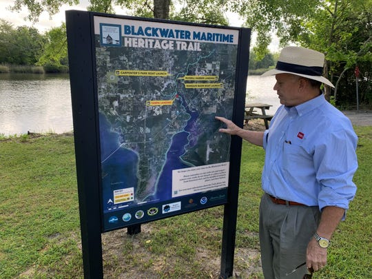 Doug Lasater, a member of the Blackwater Pyrates and Bagdad Waterfronts groups, examines one of four kiosks that were recently installed at historic sites around Milton and Bagdad. The kiosks outline the Blackwater Maritime Heritage Trail, a new project that seeks to merge history with the outdoors and encourage people to learn more about the Blackwater River's past.