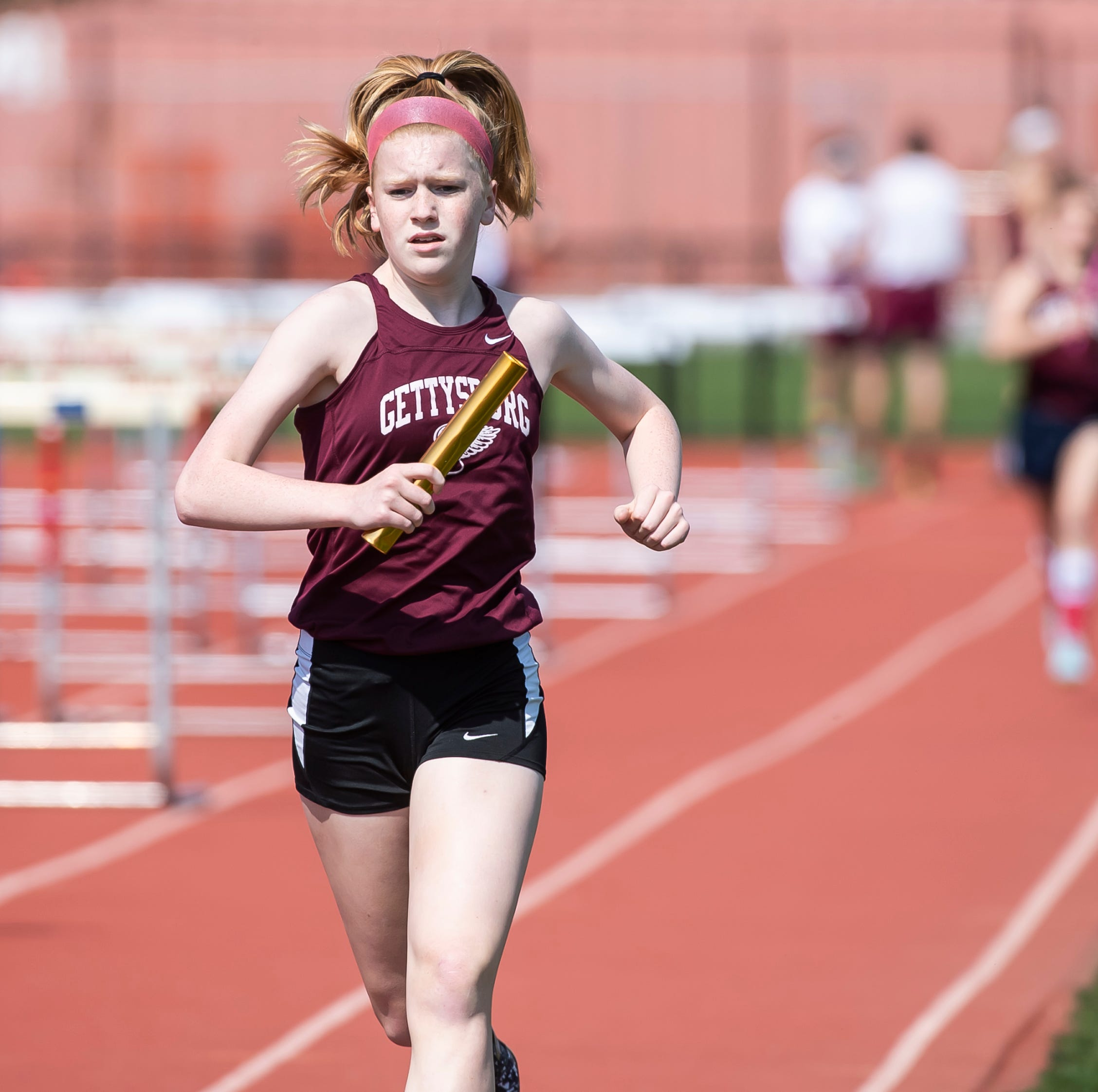Reliable relays propel New Oxford boys, Gettysburg girls to division championships