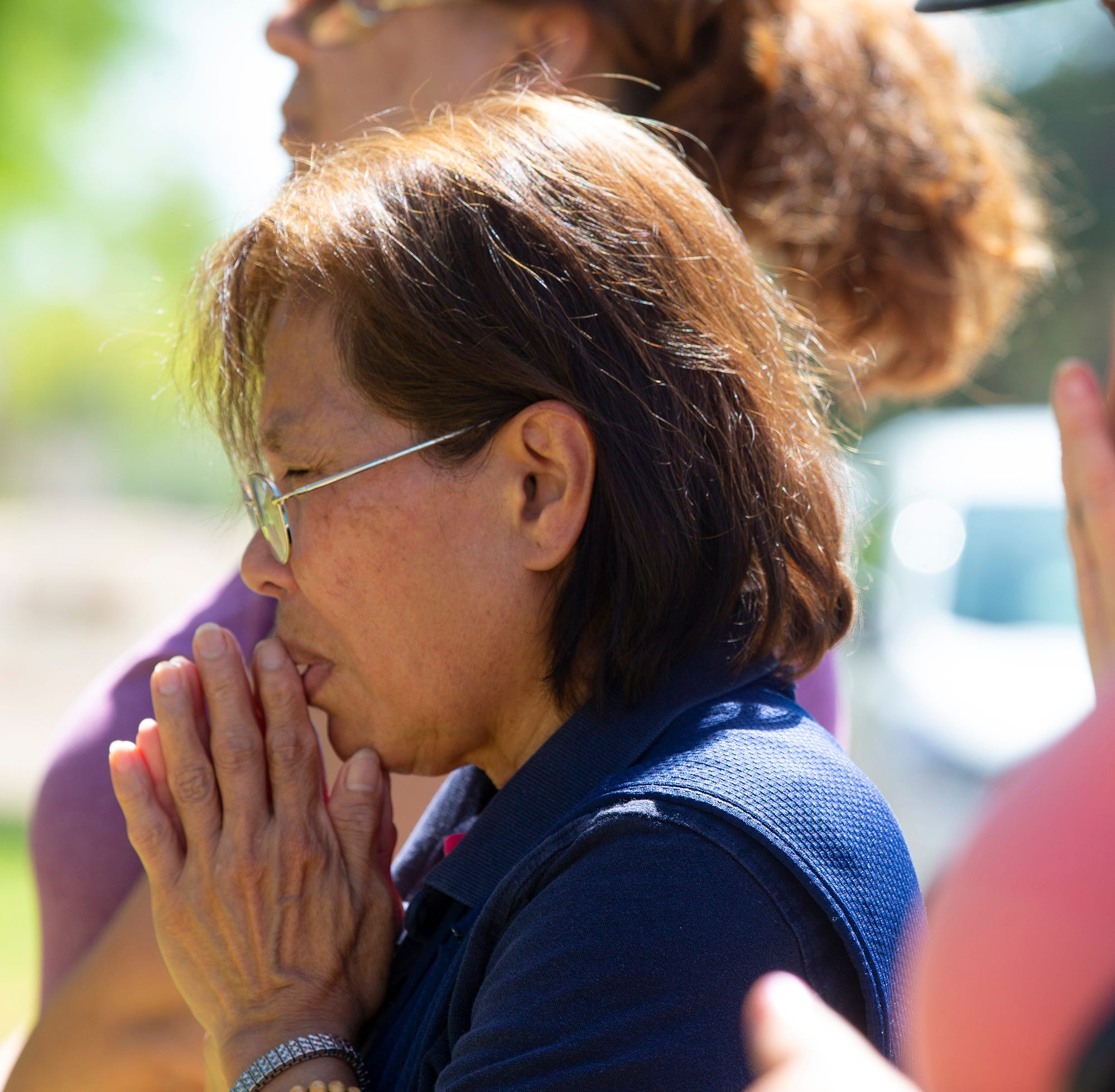 As their church lay in smoldering ruins, St. Joseph's parishioners gather for Mass