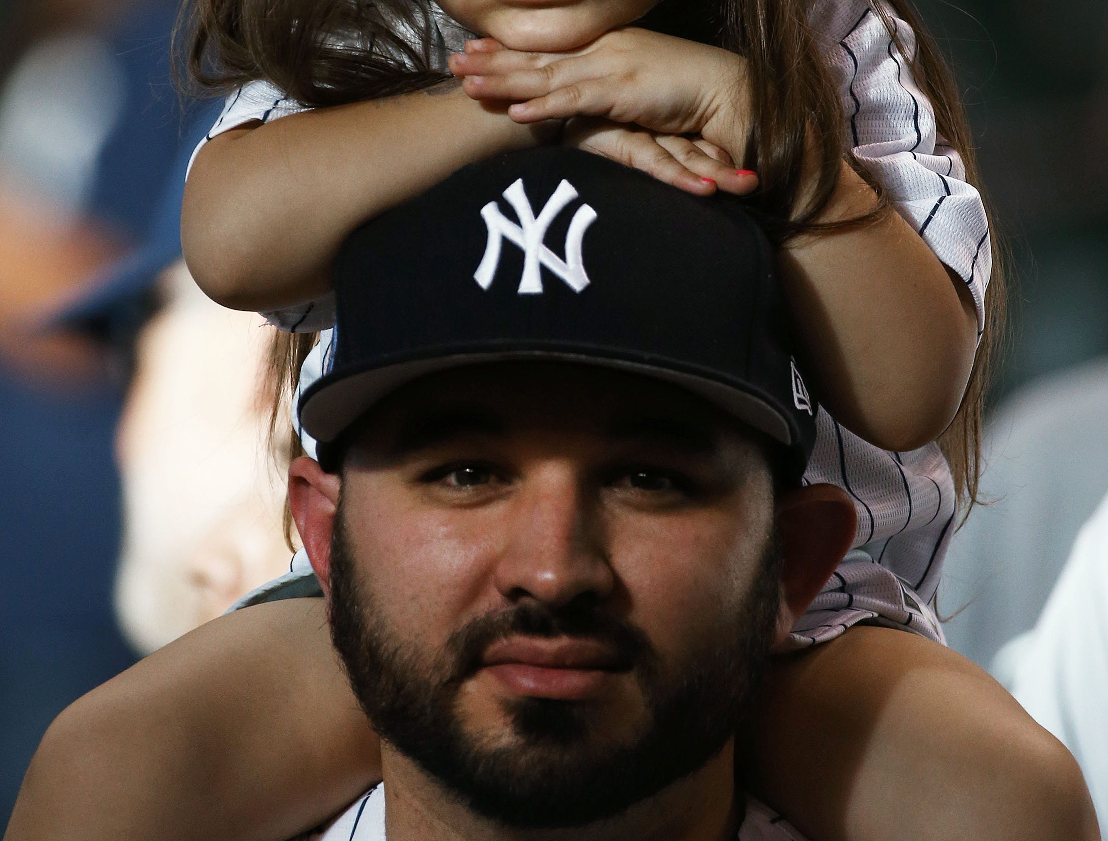 New York Yankees fan Shawn Martin from Denver, Colo., gives his daughter Ava age 4, a better view of the Yankees batting practice at the Arizona Diamondbacks game on Apr. 30, 2019 at Chase Field in Phoenix, Ariz.