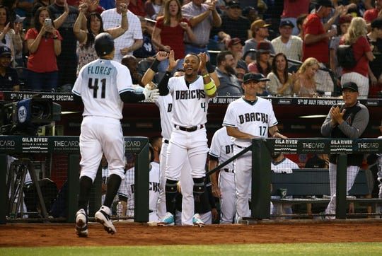 Ketel Marte reacts after Wilmer Flores' home run – his first with the Diamondbacks – in the second inning on Tuesday.