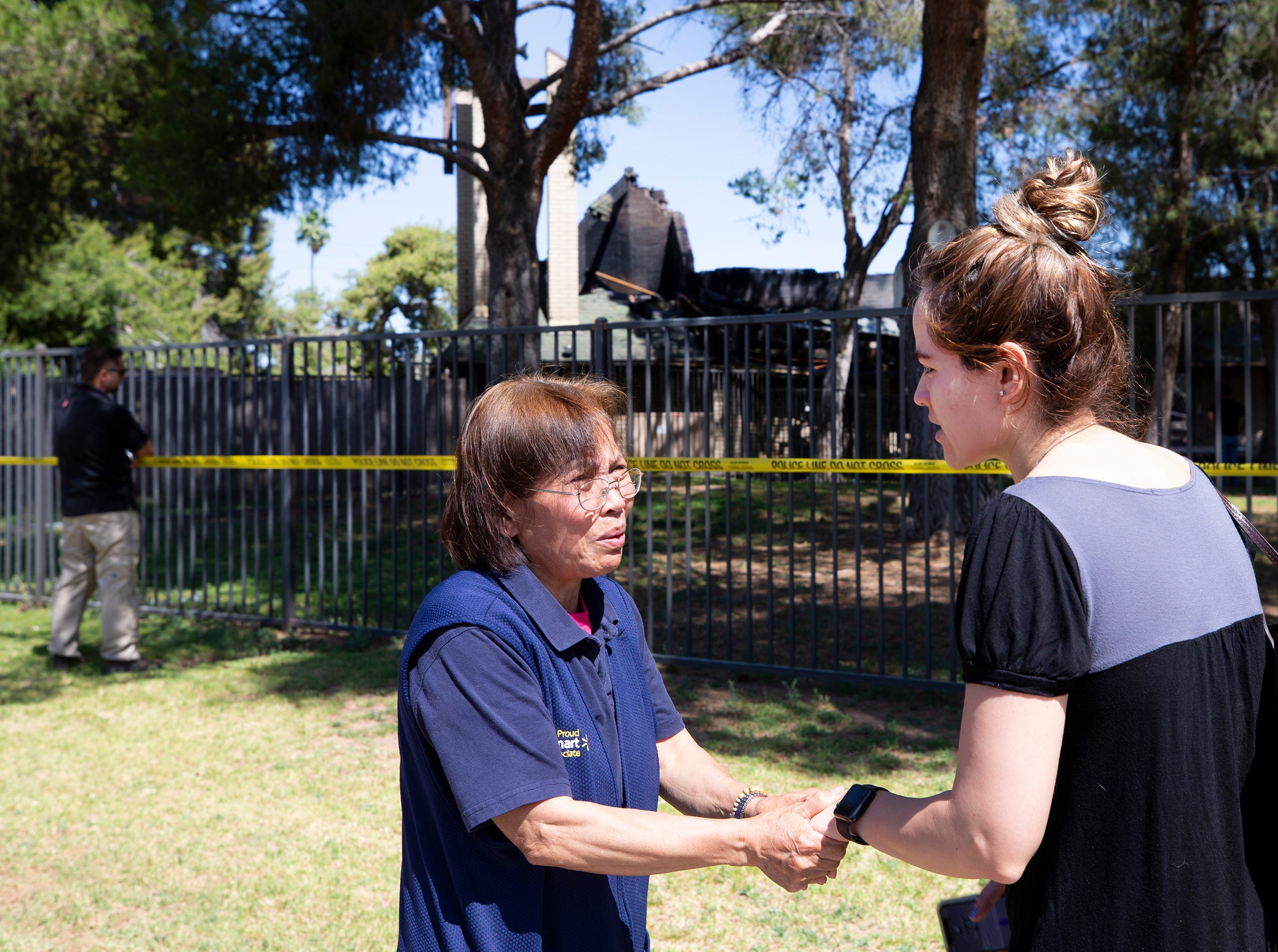 Parishioner Virginia Legarce (left) and Meredith Sanchez-Castillo console each other outside St. Joseph Catholic Church in Phoenix on May 1, 2019, after a fire destroyed most of the church.
