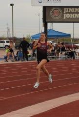 Niki Hemmerlin runs an 800 meter race for Red Mountain
