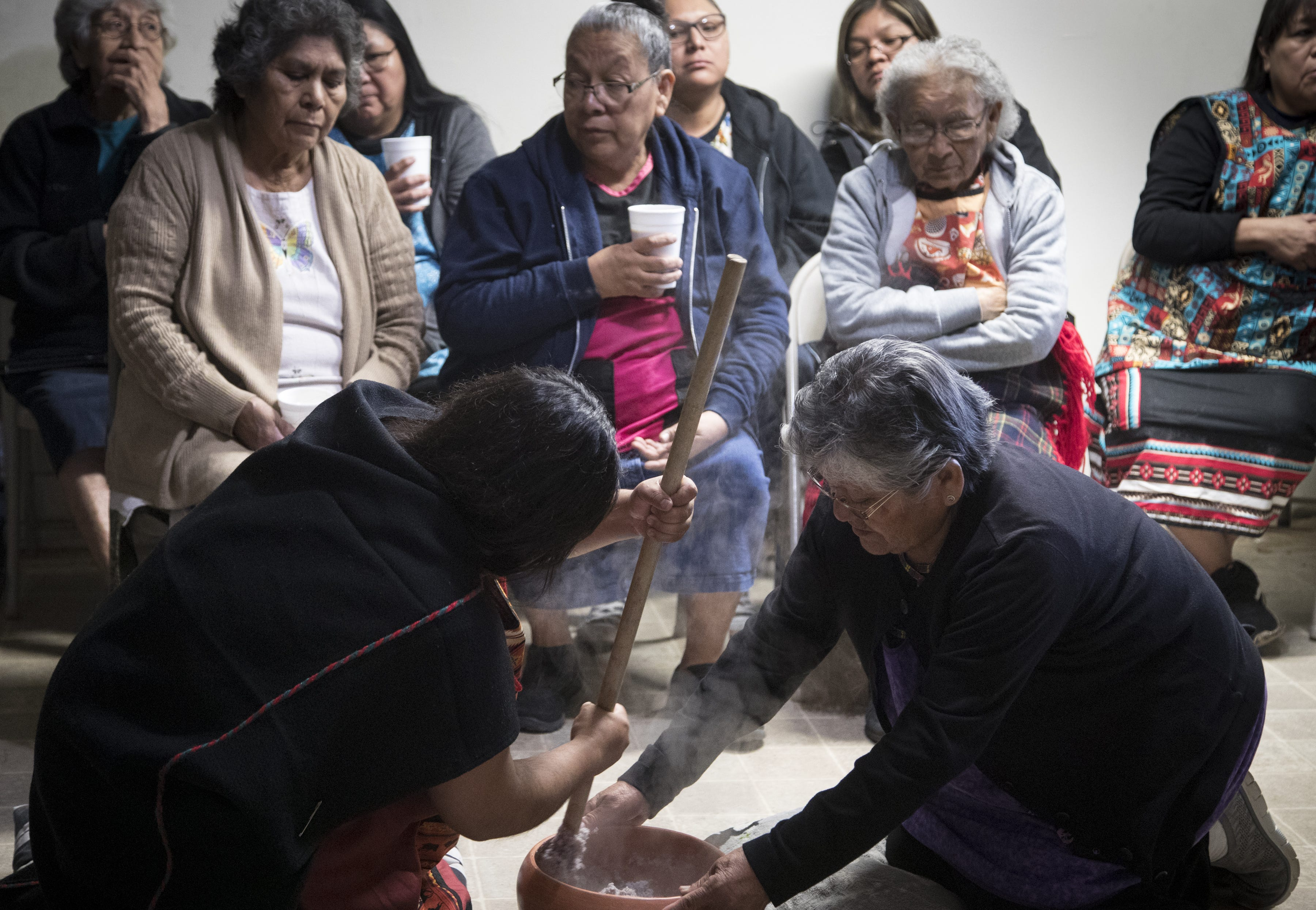 Kara (left) and Eva Iomawaima make the mixture needed for piki bread. Piki bread is a paper-thin blue corn bread cooked over a fire using a stone cook top.