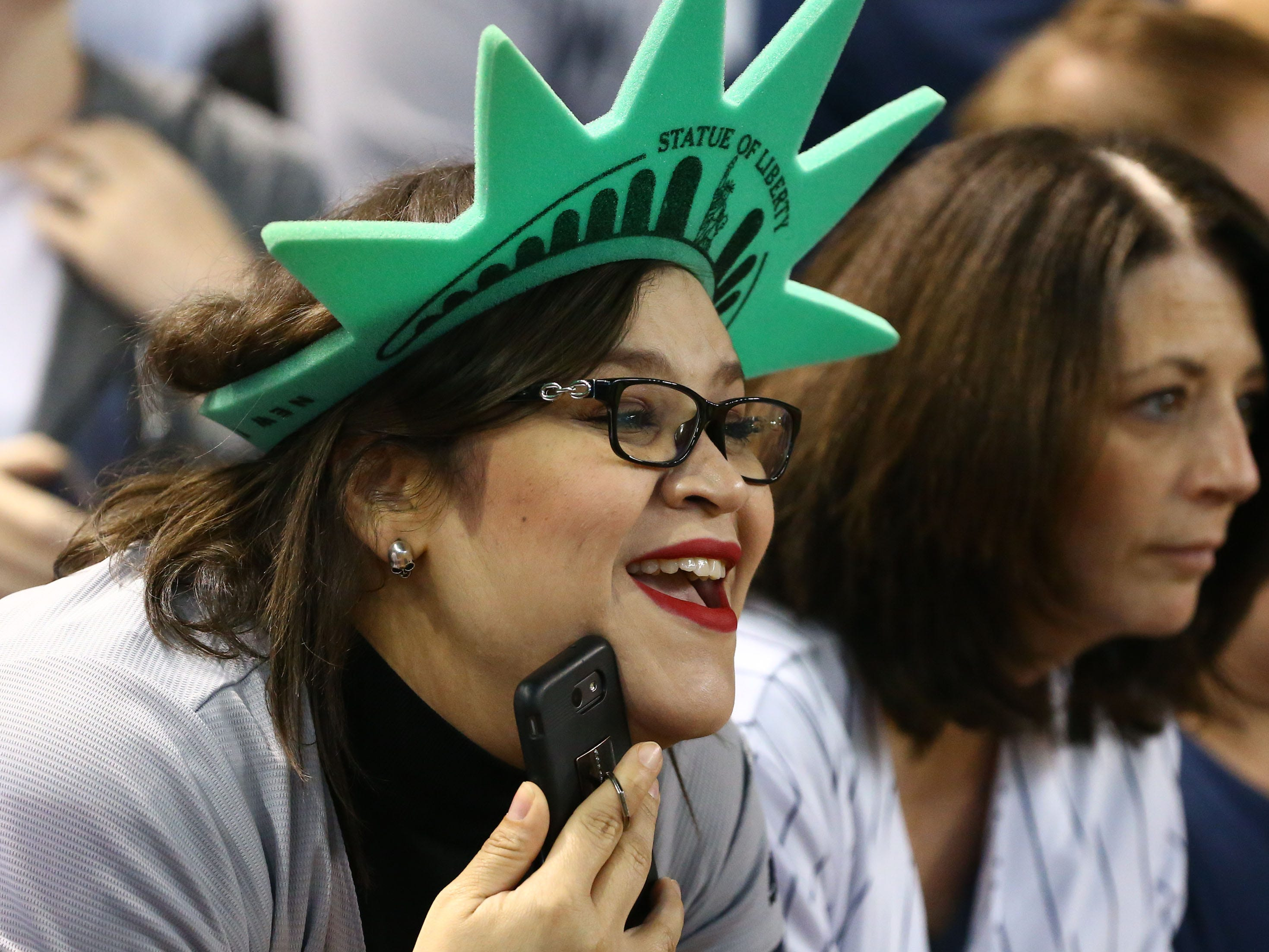 New York Yankees fan Whitney Quiroz from El Centro, Cal. watches the Yankees warm-up on Apr. 30, 2019 at Chase Field in Phoenix, Ariz.