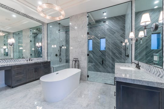 The Scottsdale home, purchased by Ann and William Smith, Jr., features a master suite that has a spa-style bathroom with a stand-alone tub.